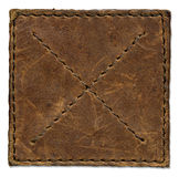 Brown scratched leather patch. With stiched edges Stock Photos