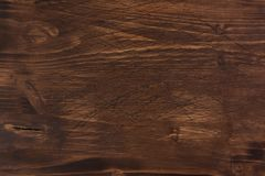 Brown scratched wooden cutting board stock photography