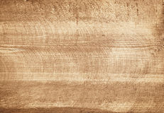 Brown scratched wooden cutting board. Stock Images