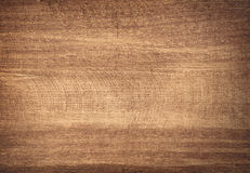 Brown scratched wooden cutting board. Royalty Free Stock Photo