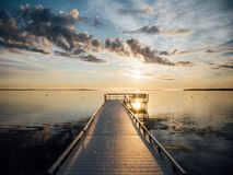 Brown Sea Dock in Front of Beach Under Calm Blue Sky Stock Photos