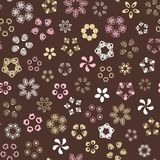 Brown seamless pattern with gold flowers. royalty free illustration