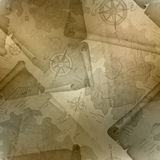 Brown seamless texture of old map of Treasure Island with a compass and manuscripts Royalty Free Stock Image