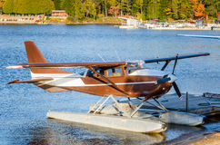 Brown Seaplane Moored to a Jetty at Sunset Stock Image