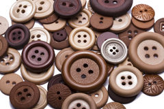 Brown sewing buttons stock photography