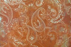 Paisley patterned background in shades brown and white. A brown shabby background covered in fancy white elaborate paisley shapes Royalty Free Stock Photos