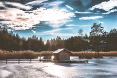 Brown Shack in the Middle of Frozen Lake Royalty Free Stock Photos