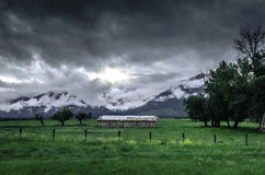 Brown Shack Under White Clouds Surrounded by Green Grass Royalty Free Stock Photo