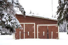 A brown shed in the snow Royalty Free Stock Photo