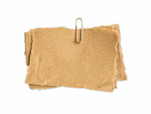 Brown sheet of paper for notes and paper clip Stock Images