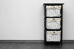 Brown shelf with wicker baskets Royalty Free Stock Photo