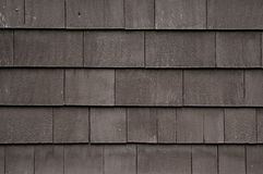 Brown shingled wall close-up Royalty Free Stock Image