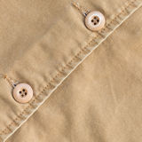 Brown shirt background with stitch seam textile Royalty Free Stock Photos
