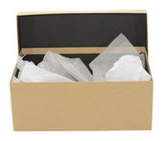 Brown shoe box. Plain brown gift box with white tissue paper Royalty Free Stock Photography