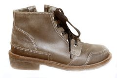 Brown old shoe. Picture of a leather brown shoe Stock Photos