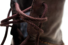 Brown shoelaces. Dark brown leather shoes, untighten shoelaces Stock Image
