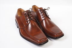 BROWN SHOES. Picture of a pair of Brown Shoes on white Stock Photo