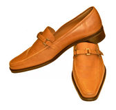 Brown shoes. Pair of a classic brown shoes Stock Image