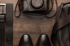 Brown shoes, belt, bag and film camera frame Stock Photo