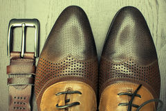 Brown shoes and belt close up Royalty Free Stock Image