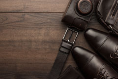 Brown shoes, belt, socks and film camera Stock Photo