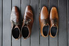 The brown shoes on the black wooden floor, Leather stock photos