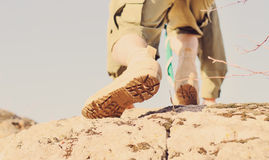 Brown Shoes of a Boy Scout Climbing a Rock Stock Image