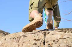 Brown Shoes of a Boy Scout Climbing a Rock Royalty Free Stock Image
