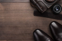 Brown shoes and film camera background Royalty Free Stock Photography
