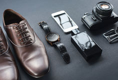 Brown shoes, film camera, telephone, clock, parfume Stock Image