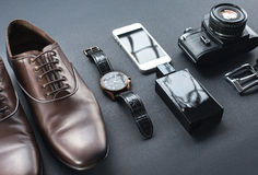 Brown shoes, film camera, telephone, clock, parfume Royalty Free Stock Photos