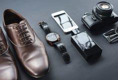 Brown shoes, film camera, telephone, clock, parfume Royalty Free Stock Photos