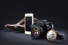 Brown shoes, film camera, telephone, clock, parfume Stock Image
