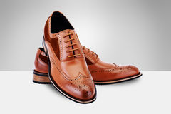 Brown Shoes. Brown Men`s Shoes on split background royalty free stock image