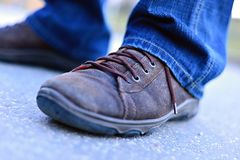 Brown shoes. Two mens shoes standing on the ground Stock Image