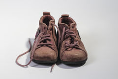 Old child shoes brown colored on white background Stock Image