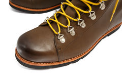 Brown shoes with yellow laces Stock Photo