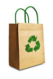 Brown shopping bag with recycle symbol. Isolated on white background royalty free stock photography