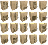 Brown shopping bags, totes, tote bags, natural, ecological paper material, sales slogans, print, Set Eco. Brown shopping bags, totes, tote bags, natural Royalty Free Stock Images