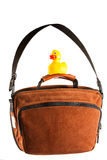 Brown Shoulder bag and rubber duck isolated on white Royalty Free Stock Photography