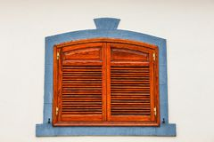 Brown shutters on a white wall royalty free stock photo
