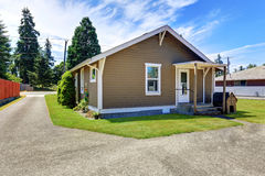 Brown siding house exterior. Back yard with concrete driveway Royalty Free Stock Photography