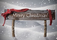 Brown Sign Merry Christmas,Snow, Snowfalkes, Red Ribbon Stock Images