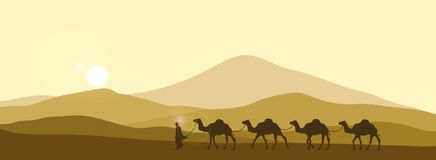 The brown silhouette of the caravan in the desert Stock Photo