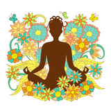 Brown silhouette girl in yoga lotus pose on floral background Stock Images
