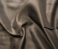 Brown silk cloth material fragment Stock Images
