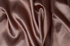 Brown Silk cloth of wavy abstract background Royalty Free Stock Photo