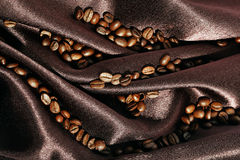 Brown silk with coffee Stock Image