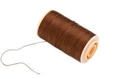 Brown  Silk Cotton Thread On Plastic Reel. Macro Shot Of Brown Silk Cotton Thread On Plastic Reel. Horizontal With White Background Stock Photo