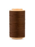 Brown Silk Cotton Thread On Plastic Reel. Royalty Free Stock Photo